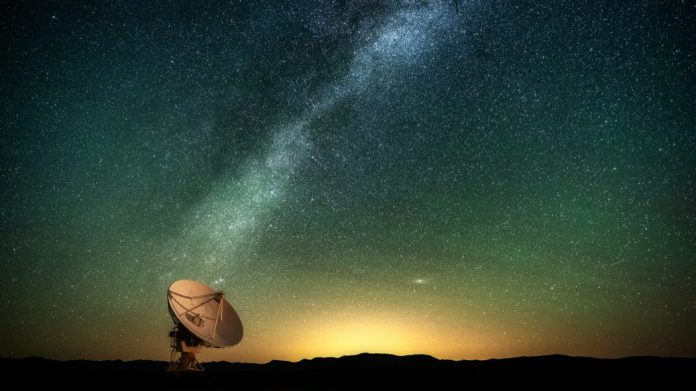 The Milky Way over a radio telescope at the Karl G. Jansky Very Large Array National Radio Astronomy Observatory in New Mexico